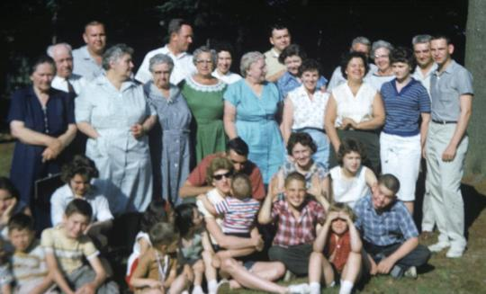 Graduation party, 1961.  I am in the front, turned to the side, with a red headband.