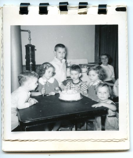 Birthday Party, 1953. I'm the little one in the full length plastic bib, watching the camera, not the cake.