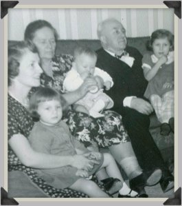 Mom, Babci, Dziadzi, my two sisters and me (the baby on Babci's lao), 1951.